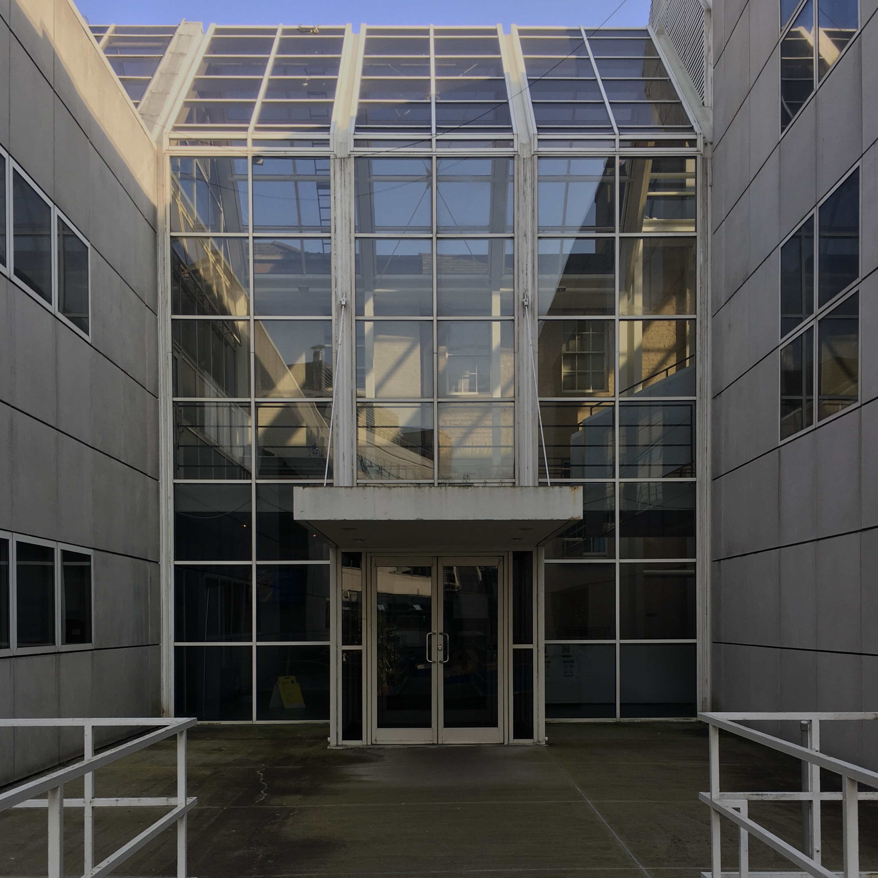 Hamilton building: The glass atrium forms an indoor street connecting to the townhouses on the outside of campus.